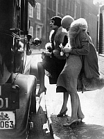 0073428 © Granger - Historical Picture ArchiveLONDON: FLAPPERS, 1929.   Two young women paying for a taxi in London, 1929.