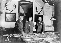 0073472 © Granger - Historical Picture ArchiveWILHELM II (1859-1941).   Wilhelm II (center), German Emperor and king of Prussia, with Paul von Hindenburg (left) and General Erich Ludendorff (right) at the military headquarters in Spa looking at the Ordnance Survey map. Photograph, 1918.