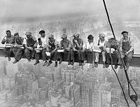 0073488 © Granger - Historical Picture ArchiveROCKEFELLER CENTER, 1932.   Workers taking a lunch on the scaffolding of Rockefeller Center during its construction in New York. Photographed by Charles Clyde Ebbets, 1932.