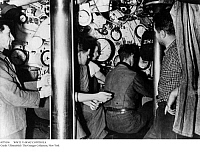 0079196 © Granger - Historical Picture ArchiveWW II: U-BOAT CONTROLS.   Engineers control the depth of a German submarine while engaging an enemy vessel in the Mediterranean. April 1942.
