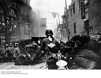 0081054 © Granger - Historical Picture ArchiveSINO-JAPANESE WAR, 1937.   Japanese troops engaged in street combat in a working-class district of Shanghai, late October 1937.