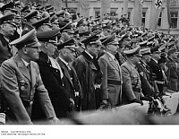 0083648 © Granger - Historical Picture ArchiveNAZI OFFICIALS, 1940.   Nazi Party officials at a demonstration at the Pariser Platz, Berlin, Germany, 18 July 1940. Front row, from left: Dr. Wilhelm Frick, Franz Gartner, Franz Seldte, Richard Walter Darre, Bernhard Rust, Dr. Robert Ley, Adolf Hahnlein, Dr. Otto Meissner; standing behind Darre is Heinrich Himmler.