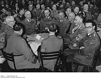 0083658 © Granger - Historical Picture ArchiveNAZI OFFICIALS, 1942.   Attendees of a Nazi Party gathering in Munich, Germany, 8 November 1942. From left: Christian Weber (back turned from camera), Franz Xaver Schwarz, Robert Ley, Alfred Rosenberg, Max Amann, Wilhelm Frick, Walter Buch, Philipp Bouhler, and Karl Fiehler (facing camera).