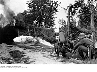 0085434 © Granger - Historical Picture ArchiveINVASION OF FRANCE, 1940.   German soldiers using a flamethrower on one of the fortifications of the Maginot Line during the invasion of France in World War II, May-June 1940.