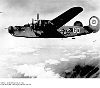 0085848 © Granger - Historical Picture ArchiveWORLD WAR II: B-24, c1944.   An American Consolidated B-24 Liberator aircraft drops bombs over Friedrichshafen, Germany. Photograph, 1944-1945.
