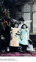 0086683 © Granger - Historical Picture ArchiveGERMANY: CHRISTMAS CARD.   German photographic Christmas card, c1902, featuring an angel with two happy little girls.