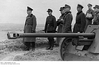 0086732 © Granger - Historical Picture ArchiveERWIN ROMMEL (1891-1944).   German Field Marshal. Rommel, commander of the German Afrika Korps, inspecting the German position at the Atlantic Wall near Fecamp, Normandy, France. Photographed 17 January 1944.