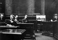 0086980 © Granger - Historical Picture ArchiveOTTO WACKER (1898-1970).   German art dealer. Wacker accused of forging 30 paintings by Vincent Van Gogh. Wacker (center) at his trial in Berlin, Germany, October 1932.