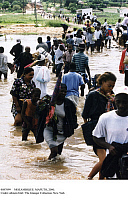 0087099 © Granger - Historical Picture ArchiveMOZAMBIQUE: MAPUTO, 2000.   Natives from Maputo, Mozambique, wading through flood waters. Photograph, 11 March 2000. Full credit: Fotoagentur imo - ullstein bild / Granger, NYC -- All Rights Reserved.