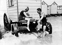 0087583 © Granger - Historical Picture ArchiveBATHING MACHINE, c1920.   Swimmers at a bathing machine. Photograph c1920.