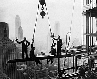 0087840 © Granger - Historical Picture ArchiveNEW YORK: WALDORF-ASTORIA.   Construction workers having lunch on a suspended I-beam during the construction of the present day Waldorf-Astoria Hotel on Park Avenue at 49th Street, New York. Photograph, c1930.