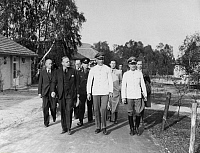 0090556 © Granger - Historical Picture ArchiveOLYMPIC VILLAGE, 1936.   Wolfgang Fürstner, manager of the Olympic Village (far right) shows German officials the complex of buildings designed by Werner March for the 1936 Summer Olympics in Berlin. To the left is Joachim von Ribbentrop, German Minister for Foreign Affairs. Photographed 18 May 1936.
