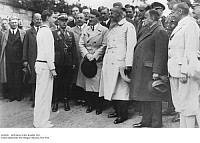 0102858 © Granger - Historical Picture ArchiveHITLER & VON CRAMM, 1933.   German chancellor meeting tennis player Gottfried von Cramm at the Deutschen Stadions in Grunewald, Berlin. At center is Reich Sports Leader Hans von Tschammer, as well as Secretary of State Hans Pfundtner. Further right is Secretary of the Interior, Dr. Wilhelm Frick, in back is architect Werner March. Photograph, 10 May 1933.