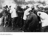 0104043 © Granger - Historical Picture ArchiveGERMANY: NUCLEAR PROTEST.   Police use a water hose on demonstrators during a protest against the NATO decision to station nuclear missiles in West Germany, 21 November 1983. Full credit: Pflaum - ullstein bild / Granger, NYC -- All rights