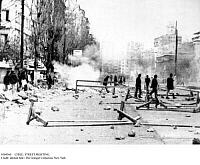 0104360 © Granger - Historical Picture ArchiveCHILE: STREET FIGHTING.   Barricades are overturned during street fighting on the Avenida Alameda in Santiago, Chile, 24 August 1973. Tear gas clouds are visible in the background.