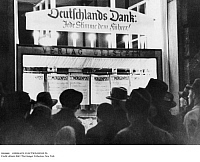 0104660 © Granger - Historical Picture ArchiveGERMANY: ELECTION RESULTS.   Germans reading election results on a public billboard, 1936.