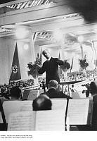 0104666 © Granger - Historical Picture ArchiveWILHELM FURTWÄNGLER   (1886-1954).   German conductor. Furtwängler directing a concert at the R. Stock and Company factory in Marienfelde, Berlin, 21 December 1939.