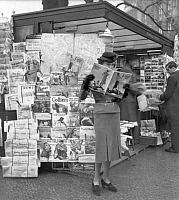 0104788 © Granger - Historical Picture ArchiveBERLIN: NEWSSTAND, 1937.   A woman reading a fashion magazine in Berlin, 1937. Photograph by Ewald Hoinkis.