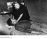 0105078 © Granger - Historical Picture ArchiveBENNO OHNESORG, 1967.   Fellow student demonstrator Friedericke Hausmann kneeling over the dying Benno Ohnesorg after he was shot by policeman Karl Heinz-Kurras near the Deutsche Oper (Opera House) during a demonstration against a visit of the Shah of Iran to West Berlin, 2 June 1967. Documents found in 2009 revealed that Heinz-Kurras was an East German spy.