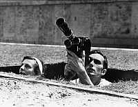 0113591 © Granger - Historical Picture ArchiveLENI RIEFENSTAHL (1902-2003).   German photographer, director and actress. Photographed by Lothar Ruebel, with cameraman, Walter Frentz, while directing her film, 'Olympia' at the Summer Olympic Games in Berlin, 1936. Full credit: Lothar Ruebelt - ullstein bild / Granger, NYC -- All rights reserved.