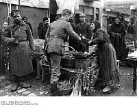 0122513 © Granger - Historical Picture ArchiveWORLD WAR I: MACEDONIA.   A German soldier buying vegetables from a market in Skopje, Macedonia. At left is a Bulgarian soldier. Photograph, spring 1916.