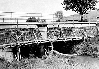 0128081 © Granger - Historical Picture ArchiveWORLD WAR I: BRIDGE.   A wooden footbridge behind the street bridge, which is under enemy observation during World War I, in Vosges, France. Photograph, 1914