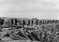0128140 © Granger - Historical Picture ArchiveWORLD WAR I: YPRES, 1917.   British troops near Zonnebeke, carrying drinking water to the front lines during the Third Battle of Ypres in Flanders, Belgium, August 1917.