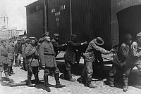 0128199 © Granger - Historical Picture ArchiveWORLD WAR I.   Finland: Military intervention of German troops (Baltic Sea division) in Finnish civil war (allied with the 'Whites') : Red guards - prisoners shifting railway boxcars closely watched by German soldiers. May/June 1918.