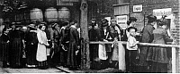 0128373 © Granger - Historical Picture ArchiveWORLD WAR I.   Food supply in Germany: people queue up in front of a counter for food stamps - no further details - 1916/17.
