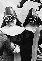 0129347 © Granger - Historical Picture ArchiveFIREFIGHTER NUNS, 1934.   Firefighting nuns wearing goggles and helmets in Ursberg, Germany. Photograph, 1934.