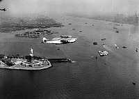 0130885 © Granger - Historical Picture ArchiveFLYING BOAT, 1931.   A German Dorner Do X flying boat circles over the Statue of Liberty in New York Harbor after its transatlantic flight. Photograph, 1931.
