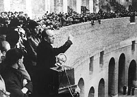 0131855 © Granger - Historical Picture ArchiveBENITO MUSSOLINI (1883-1945).   Italian political leader. Mussolini giving a speech at the Colosseum in Rome to commemorate the anniversary of the October 1922 March on Rome by the Italian Fascist Party. Photograph, 28 October 1926.