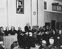 0133025 © Granger - Historical Picture ArchiveISREAL: INDEPENDECE, 1948.  Prime Minister David Ben Gurion reads out on the eve of the independence the proclamation of the State of Israel in the City Museum of Art. Photograph, May 1948.