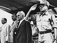 0133054 © Granger - Historical Picture ArchiveISRAEL.  Founding of Israel and following events : 'Nation Day', with Minister Jizchak Gruenbaum (Interior), Eilozer Kaplan (Finance), David Ben Gurion (PM) and Jaakow Dori (Chief of Staff Army). Photograph, 1948.