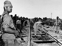 0133110 © Granger - Historical Picture ArchiveMIDDLE EAST WARS.   Egyptian workers under Israeli supervision repairing the tracks of the railway line Gaza - Tel Aviv. Photograph, November 1956.