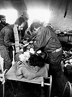 0133125 © Granger - Historical Picture ArchiveYOM KIPPUR WAR.  A badly injured Israeli soldier receives first aid in an emergency hospital behind combat zone, Sinai. Photograph, October 1973.