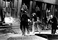 0133514 © Granger - Historical Picture ArchiveGERMANY: STEEL FACTORY.   Workers at a Siemens-Martin open-hearth furnace in a steel factory in Bochum, West Germany. Photograph, 1950s.