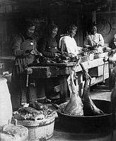 0133745 © Granger - Historical Picture ArchiveINUIT WOMEN COOKING, c1910.   A group of Inuit women in Labrador, Canada, preparing reindeer meat. Photograph, c1910. Full credit: Haeckel-Archiv - ullstein bild / Granger, NYC -- All Rights Reserved.
