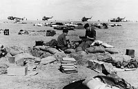 0163066 © Granger - Historical Picture ArchiveEGYPT: SUEZ CRISIS, 1956.   Two British paratroopers manning a foxhole at an airfield near Port Said, Egypt, at the time of the Suez Crisis, 11 November 1956.