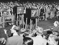 0163251 © Granger - Historical Picture ArchiveTELEVISION EXHIBIT, 1951.   Crowd of people at an RCA television exhibit in a park in Schöneberg, West Berlin, August 1951.