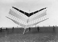 0164082 © Granger - Historical Picture ArchiveGERMANY: LARGE KITE, 1912.   A large kite that can transport three people in its basket. Photograph by Robert Sennecke, 1912.