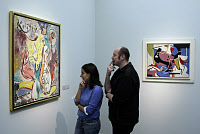 0164106 © Granger - Historical Picture ArchiveCOLOGNE: ART MUSEUM, 2008.   A couple looking at the painting 'Magic Flame,' by Jackson Pollock, at the Wallraf-Richartz Museum in Cologne, Germany. In the background is Lee Krasner's 'Lavender,' c1942. Photograph, 29 October 2008. Full credit: Brill - ullstein bild / Granger, NYC -- All rights rese