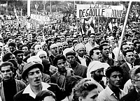 0166920 © Granger - Historical Picture ArchiveALGERIAN WAR, 1954-1962.   Around 45,000 people gathered in Algiers, including around 5,000 Algerians; banner reads 'De Gaulle to power.' Photograph, 13.05.1958.