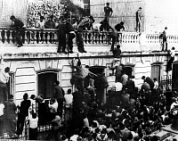 0166921 © Granger - Historical Picture ArchiveALGERIAN WAR, 1954-1962.   Demonstrators storming the French prefecture in Oran after the 'coup' of Algiers which ended the Fourth Republic of France and brought Charles de Gaulle to power. Photograph, 5/15/1958.