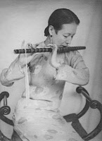 0168981 © Granger - Historical Picture ArchiveCHINESE WOMAN, 1934.   Princess Dan Pao-dschao, lady-in-waiting of the last empress of China, playing a flute. Photograph, 1934. Full credit: Walter Bosshard - ullstein bild / Granger, NYC -- All Rights Reserved.