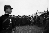 0169283 © Granger - Historical Picture ArchiveFROYAL VISIT FROM SPAIN.   Fontainebleau Alfonso XIII (1886-1941), King of Spain, and the French Prime Minister Raymond Poincaré (1860-1934) look at aircrafts at an airfield. Shaking hands with the pilot Guillaux. Photographed by, M. Rol, 1913.