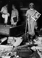 0169459 © Granger - Historical Picture ArchiveIRAQ COUP, 1958.   Military coup d'état, July 14th, 1958: overthrow of King Faisal II. Iraqi soldier inside the sacked palace of Prince Abdul Ilah, carrying a poster of the overthrown King Faisal. Photograph, 23.07.1958.