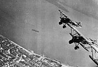 0169564 © Granger - Historical Picture ArchiveSPANISH CIVIL WAR.   1936-39. Combat in the north: a flight of Italian Legione Redenta fighter planes (Fiat CR.32) above Santander. Photograph, summer 1937.