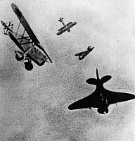 0169565 © Granger - Historical Picture ArchiveSPANISH CIVIL WAR.   1936-39. Dogfight above Castilla between fighter planes, a Fiat CR.32 of Italian origin and a Soviet-made Polikarpov I-16 ('Rata'). Photograph, 1938.