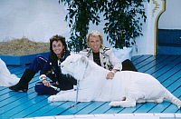 0169977 © Granger - Historical Picture ArchiveSIEGFRIED AND ROY, 1991.   German-American entertainers Siegfried Fischbacher and Roy Horn with a white tiger used in their act. Photograph, 1991. Full credit: Teutopress - ullstein bild / Granger, NYC -- All rights reserved. EDITORIAL USE